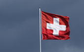 Swiss flag flies under dark clouds over the Swiss embassy on August 25 2010 in Berlin Germany Switzerland and Germany have had repeated arguments...