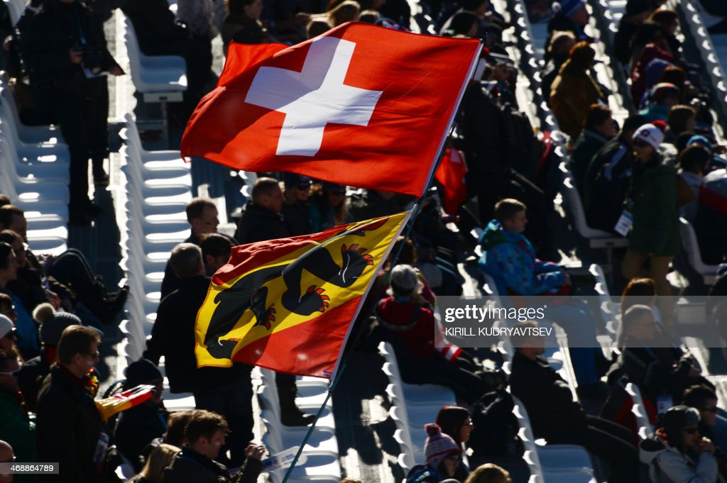 A Swiss flag flys at the start of the Women's Alpine Skiing Downhill at the Rosa Khutor Alpine Center during the Sochi Winter Olympics on February 12, 2014.