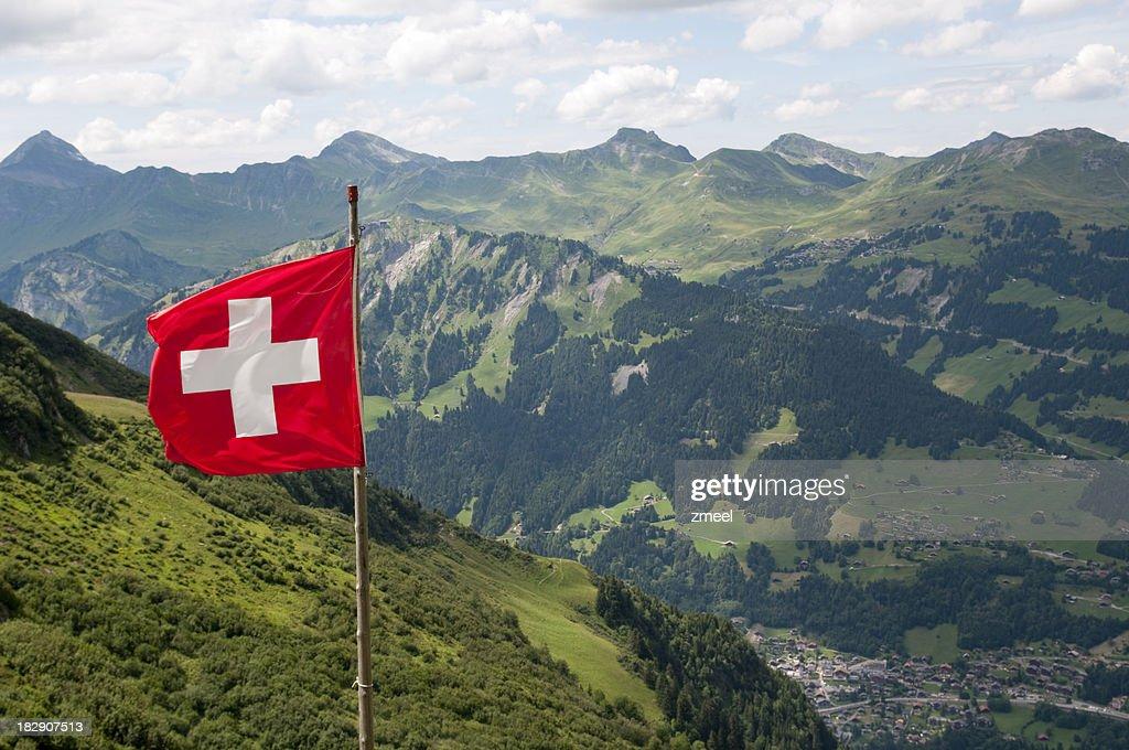 Swiss flag over Alps