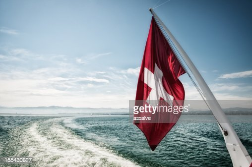 Swiss flag waving in the wind during a sailing boat trip