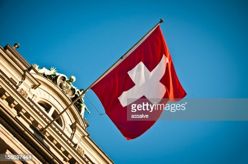 swiss flag waving on historic building