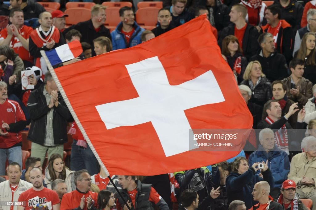 A Swiss flag with a small French flag on its top floats prior to the Euro 2016 qualifying football match between Switzerland and Slovenia at the St. Jakob park stadium in Basel on September 5, 2015.