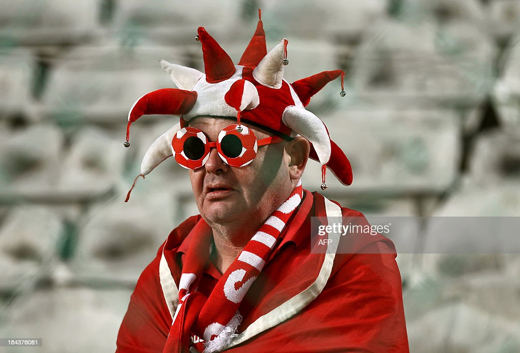 A Swiss football fan attends the 2014 World Cup European zone group E qualifying football match between Cyprus and Switzerland at GSP Stadium in Nicosia on March 23, 2013.