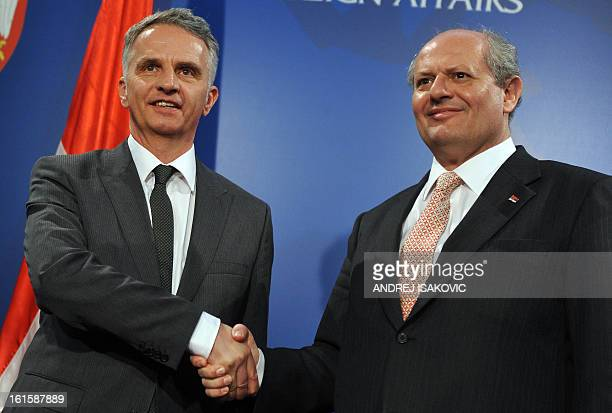Swiss Foreign Minister Didier Burkhalter shakes hands with his Serbian counterpart Ivan Mrkic prior to their meeting in Belgrade on February 12 2013...