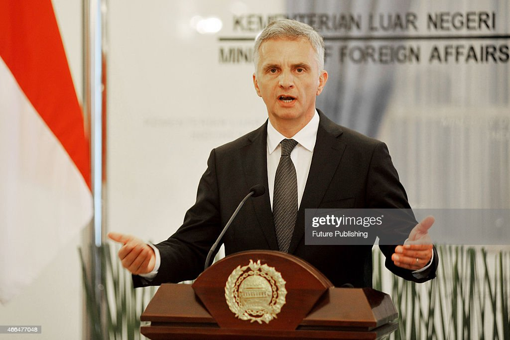 Swiss Foreign Minister <a gi-track='captionPersonalityLinkClicked' href=/galleries/search?phrase=Didier+Burkhalter&family=editorial&specificpeople=6269147 ng-click='$event.stopPropagation()'>Didier Burkhalter</a> talk to journalists during a joint news conference on March 16, 2015 in Jakarta, Indonesia. Burkhalter visits Indonesia to boost ties and economic partnerships between the two countries. Jefta Images / Barcroft Media