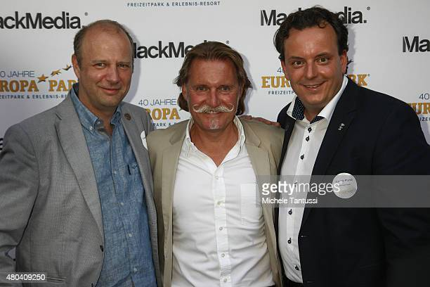 Swiss former professional road racing cyclist Tony Rominger Ingo Lenssen and Thomas Mack pose during EuropaPark's 40th Anniversary at the EuropaPark...