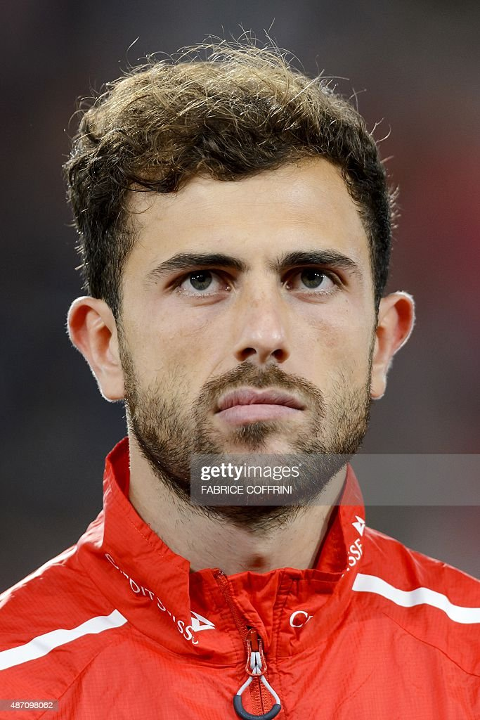 Swiss forward Admir Mehmedi stands during the national anthem prior to the Euro 2016 qualifying football match between Switzerland and Slovenia at the St. Jakob Park Stadium in Basel on September 5, 2015. Switzerland defeated Slovenia 3-2.
