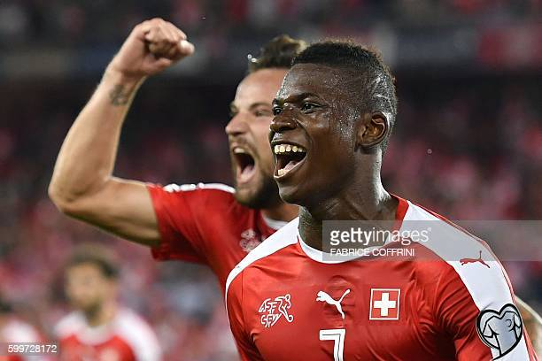 Swiss forward Breel Embolo celebrates his team's first goal with teammate forward Haris Seferovic during the FIFA World Cup WC 2018 football...