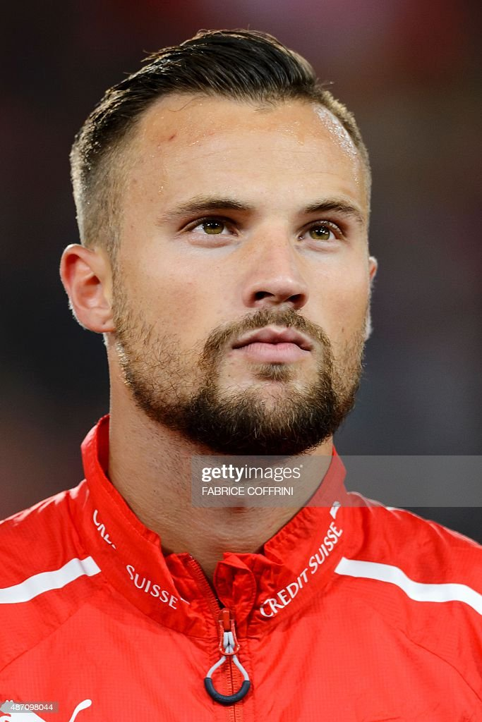 Swiss forward Haris Seferovic stands during the national anthem prior to the Euro 2016 qualifying football match between Switzerland and Slovenia at the St. Jakob Park Stadium in Basel on September 5, 2015. Switzerland defeated Slovenia 3-2.