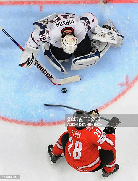 Swiss forward Martin Pluss attacks US goalkeeper John Gibson during the semi final match Switzerland vs United States of the 2013 IIHF International...