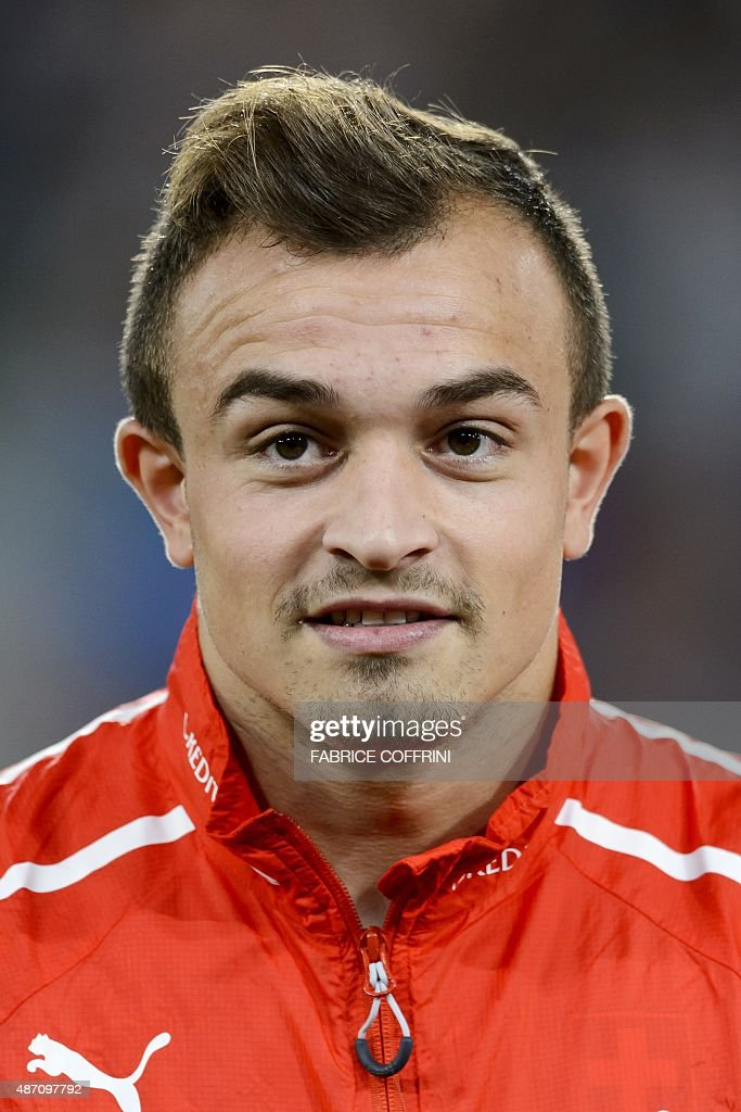Swiss forward Xherdan Shaqiri stands during the national anthem prior to the Euro 2016 qualifying football match between Switzerland and Slovenia at the St. Jakob Park Stadium in Basel on September 5, 2015. Switzerland defeated Slovenia 3-2.