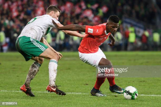 Swiss foward Breel Embolo and Northern Ireland's defender Jonny Evans vie for the ball during the FIFA 2018 World Cup playoff second leg qualifying...