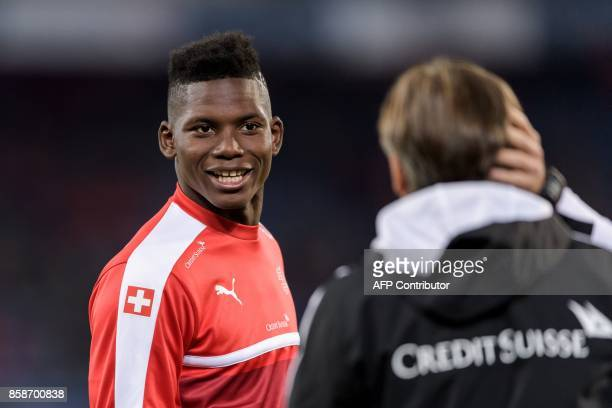 Swiss foward Breel Embolo smiles during a warm up sesison prior to the the FIFA World Cup WC 2018 football qualifier match between Switzerland and...