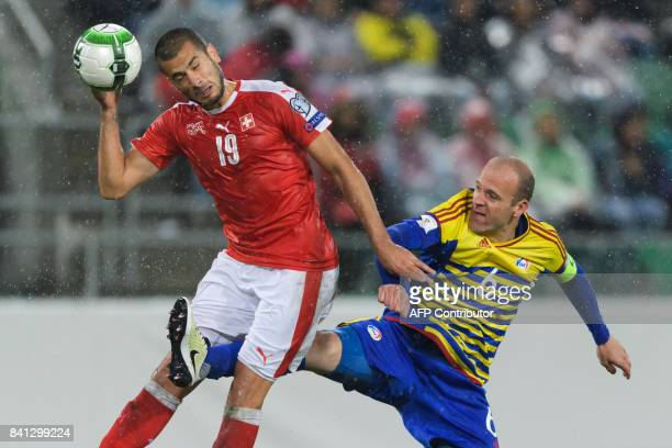 TOPSHOT Swiss foward Eren Derdiyok and Andorra's defender Ildefons Lima vie for the ball during the 2018 FIFA World Cup qualifying football match...