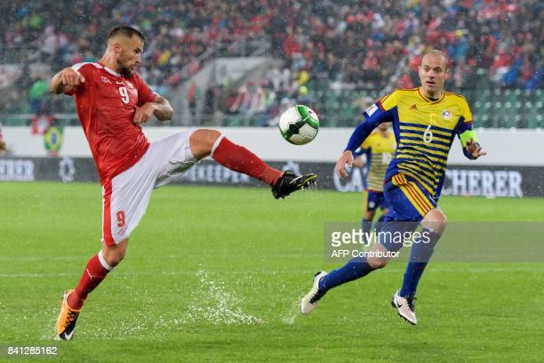 Swiss foward Haris Seferovic vies with Andorra's defender Ildefons Lima during the FIFA World Cup WC 2018 football qualifier between Switzerland and...