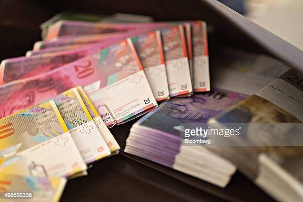 Swiss Franc banknotes sit in the office of a bank in this arranged photograph in Zurich Switzerland on Friday Nov 20 2015 The franc is still too...