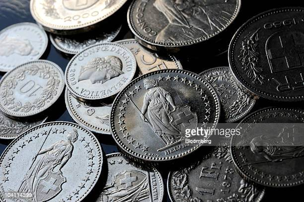 Swiss Franc coins are seen arranged for a photograph in Biel Switzerland on Monday Sept 13 2010 Switzerland's BAK economic institute said it expects...