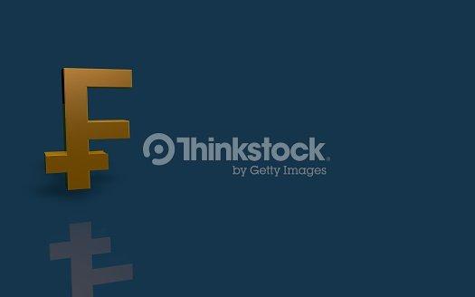 Swiss Franc Gold Symbol On Blue Background Stock Photo Thinkstock