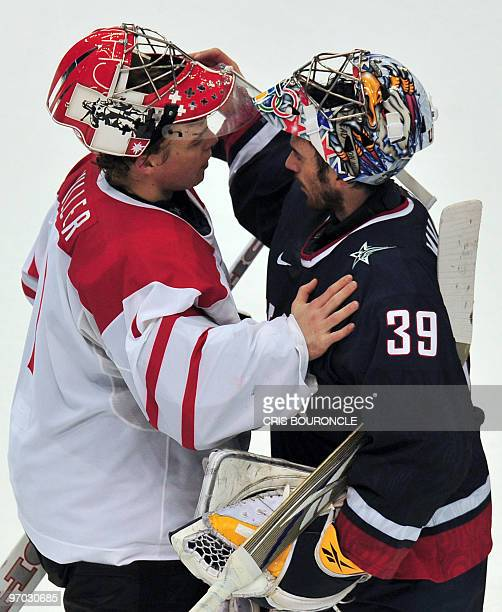 Swiss goalkeeper Jonas Hiller greats USA's goal keeper Ryan Miller following the Men's Ice Hockey Quarterfinals game at the Canada Hockey Place...