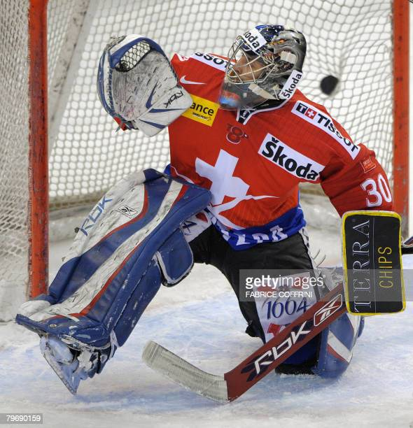 Swiss goalkeeper Thomas Baeumle fails to stop a puck from France during the international ice hockey Skoda Cup tournament on February 10 2008 in...