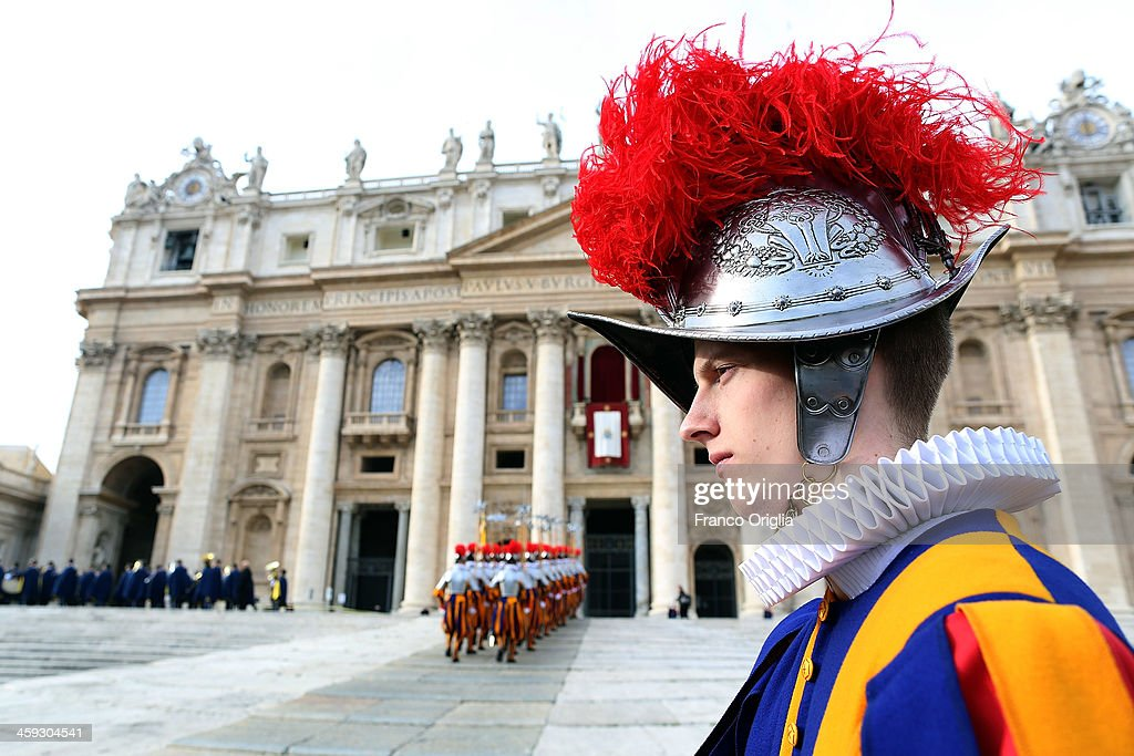 A Swiss Guard attends Pope Francis' Christmas Day message from the central balcony of St Peter's Basilica on December 25, 2013 in Vatican City, Vatican. The 'Urbi et Orbi' blessing (to the city and to the world) is recognised as a Christmas tradition by Catholics with the Pope Francis focusing this year on the peace in the world.