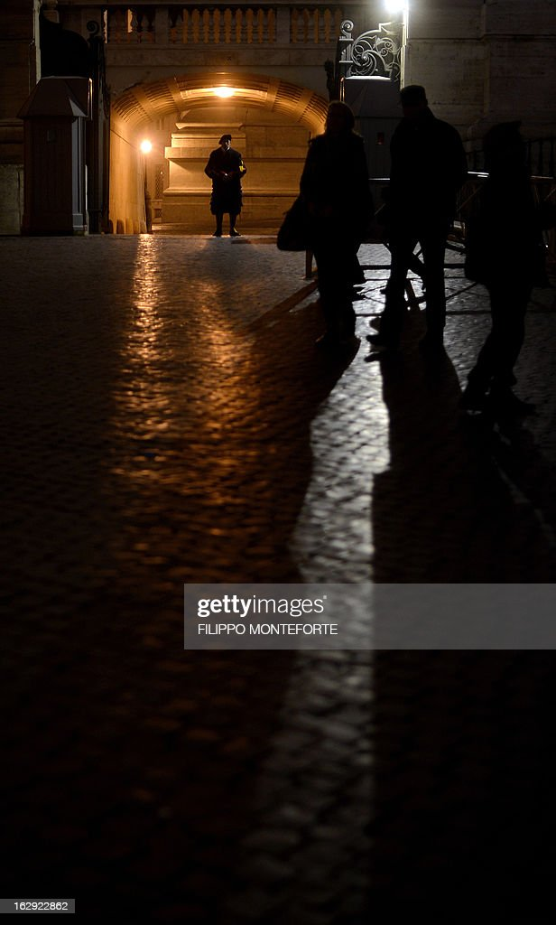 A Swiss guard stands at the St.Peter's Square in the Vatican on March 01, 2013. Pope Benedict XVI has become the day before the first pope to resign in over 700 years, telling a tearful crowd of faithful that he will now be 'a simple pilgrim' as cardinals on Friday begin preparing for a conclave in the Sistine Chapel to elect his successor.
