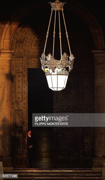 A swiss guard stands by the Bronze door of StPeter's Basilica in the early hours of 02 April 2005 Vatican spokesman Joaquim Navarro Valls said ' The...