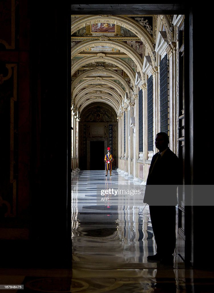 A Swiss guard stands in a corridor during a private audience of the pontiff with the Lebanese President at the Vatican on May 3, 2013.