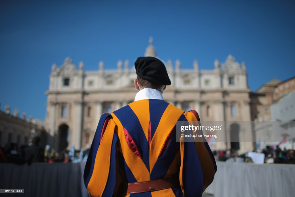 A Swiss guard stands in front of the Vatican as Pope Benedict XVI delivers his final general audience in St Peter's Square before his retirement on February 27, 2013 in Vatican City, Vatican. The Pontiff has held his last weekly public audience before stepping down tomorrow. Pope Benedict XVI has been the leader of the Catholic Church for eight years and is the first Pope to retire since 1415. He cites ailing health as his reason for retirement and will spend the rest of his life in solitude away from public engagements.