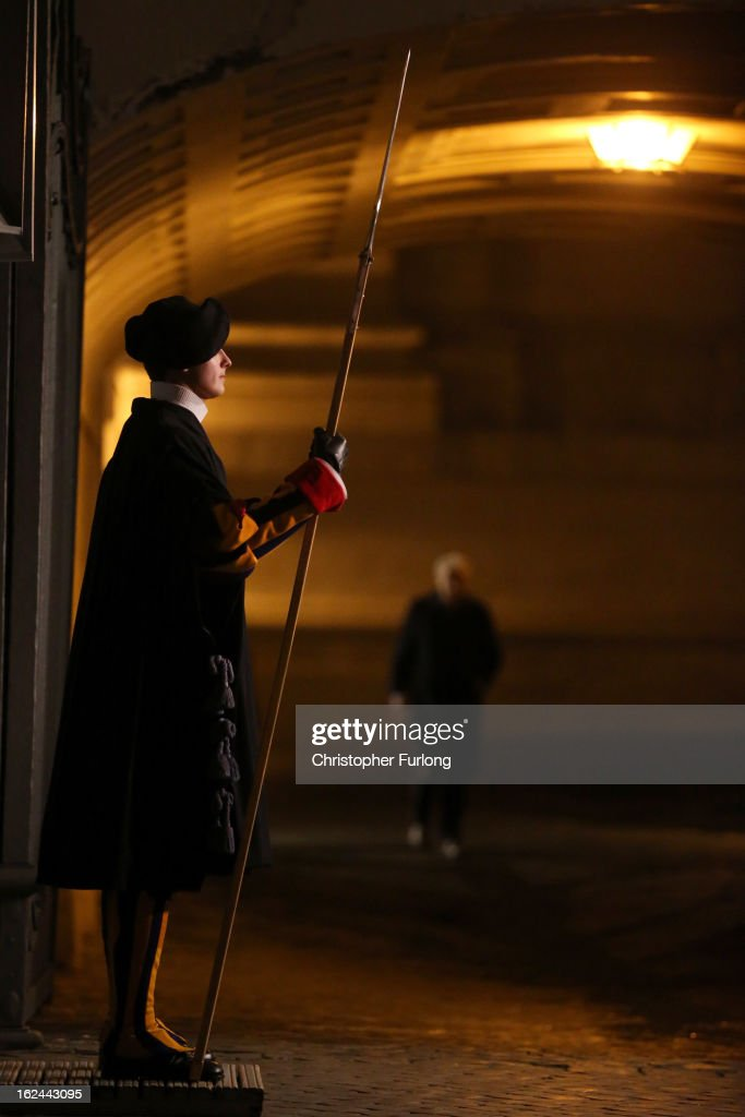 A Swiss Guard stands on duty at the entrance to the Vatican in Saint Peter's Square on February 23, 2013 in Vatican City, Vatican. Pope Benedict XVI is due to hold his last Angelus blessing tomorrow before he retires on Thursday. Pope Benedict XVI has been the leader of the Catholic Church for eight years and is the first Pope to retire since 1415. He cites his retirement due to ailing health and is to spend the rest of his life in solitude away from any public engagements.