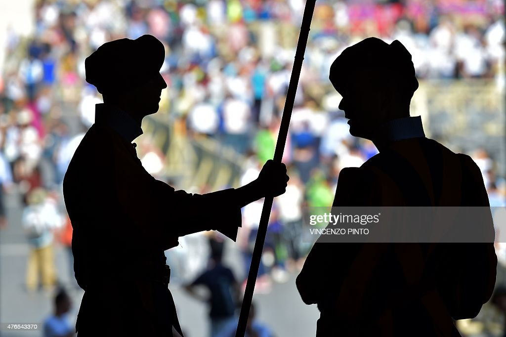 Swiss Guards are silhouetted on June 10, 2015 in Vatican prior the arrival of Russian President Vladimir Putin for a private audience with Pope Francis.