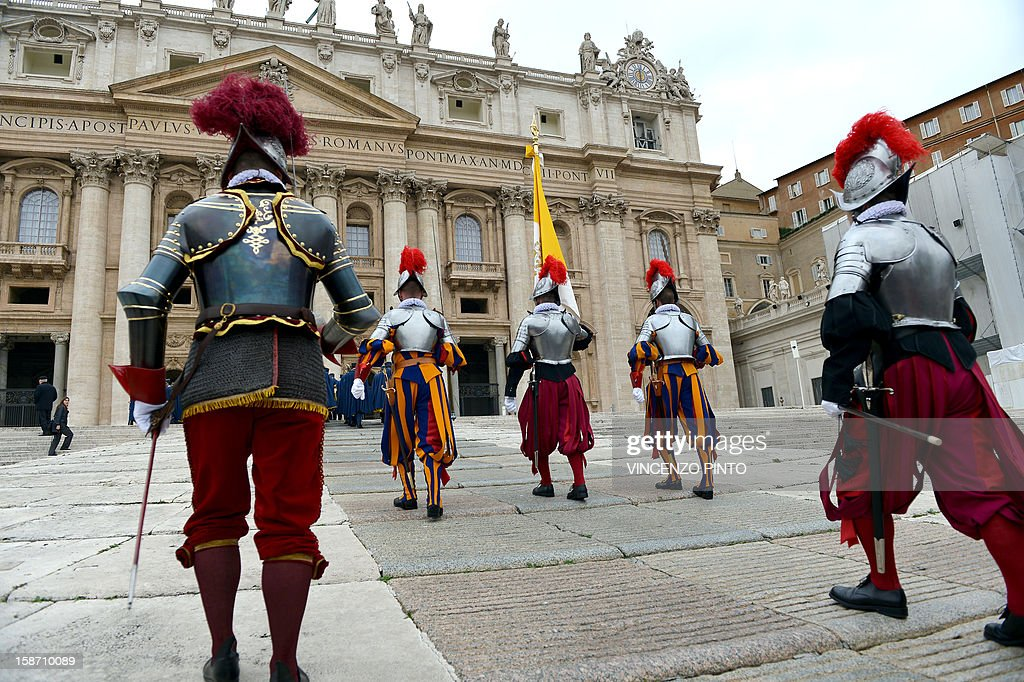 Swiss guards arrive for Pope Benedict XVI 's traditional Christmas 'Urbi et Orbi' blessing from the balcony of St. Peter's Basilica at the Vatican on December 25, 2012.