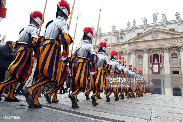 Swiss Guards arrive in St Peter's Square to attend Pope Francis' Christmas Day message from the central balcony of St Peter's Basilicaon December 25...