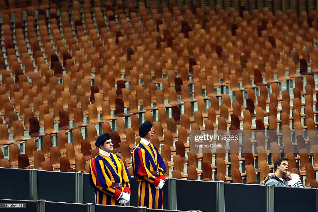 Swiss guards attend the weekly audience held by Pope Benedict XVI at the Paul VI Hall on January 9, 2013 in Vatican City, Vatican. The Pontiff gave the catechesis dedicated to the Year of Faith, during his regularly scheduled Wednesday general audience.