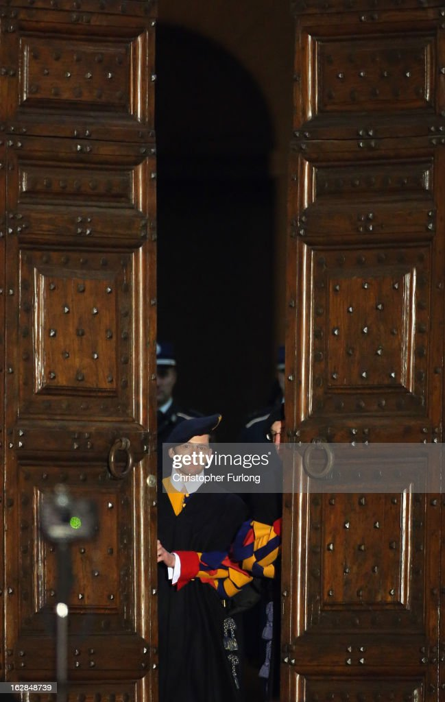 Swiss Guards close the doors to Pope Benedict XVI's residence in Castel Gandolfo as he starts his retirement on February 28, 2013 in Rome, Italy. Pope Benedict XVI has been the leader of the Catholic Church for eight years and is the first Pope to retire since 1415. He will stay at the Papal Summer residence of Castel Gandolfo until renovations are complete at a monastery in the grounds of the Vatican and will be known as Roman Pope Emeritus.