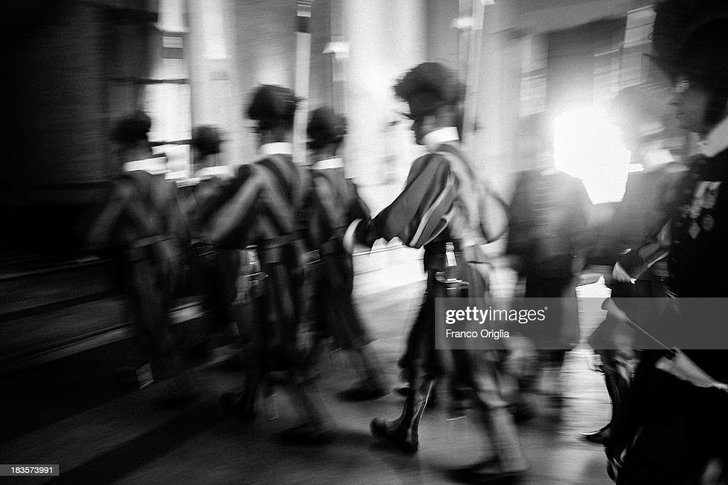 Swiss guards enter to the Apostolic Palace on October 7, 2013 in Vatican City, Vatican. After the success of his Social networking accounts of Twitter and Facebook, Pope Francis joined Instagram, reporting today more than 8000 followers.