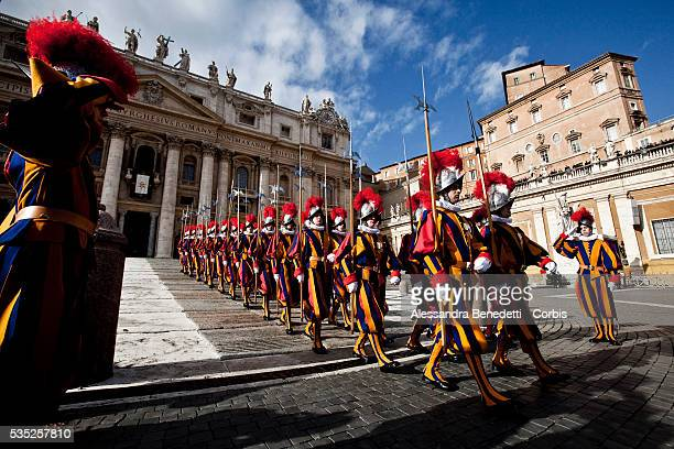 Swiss Guards leave St Peter's Square at the Vatican at the end of Pope Benedict XVI's delivery of the 'Urbi et Orbi' message Questions regarding the...