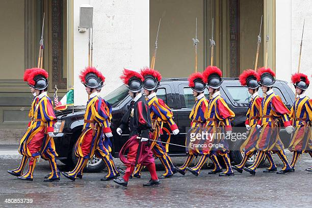 Swiss Guards salute as US President Barack Obama leaves in his car after the meeting with Pope Francis at his private library in the Apostolic Palace...