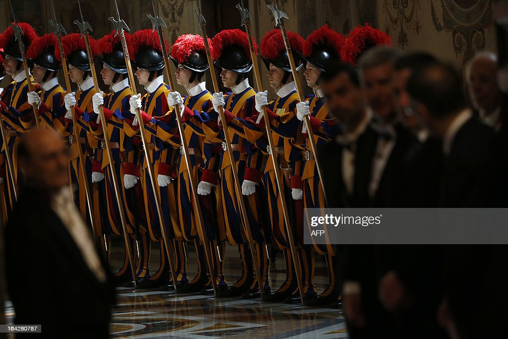 Swiss guards stand as Pope Francis attends an audience with the diplomatic corps at the Vatican on March 22, 2013. Pope Francis called for the Roman Catholic Church to 'intensify' its dialogue with Islam, echoing hopes in the Muslim world for better ties with the Vatican during his reign.
