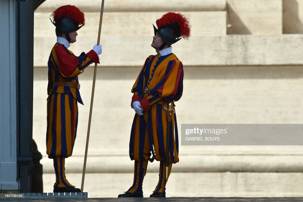 Swiss guards stand at St Peter's square on March 27, 2013 before a papal audience at the Vatican.