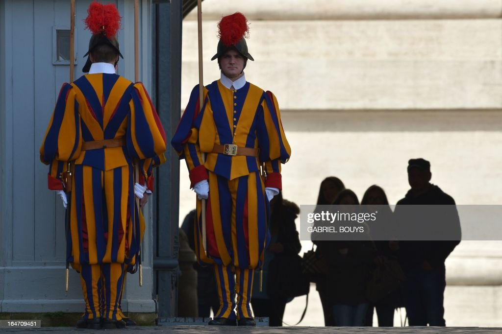 Swiss guards stand at St Peter's square on March 27, 2013 before a papal audience at the Vatican. AFP PHOTO / GABRIEL BOUYS