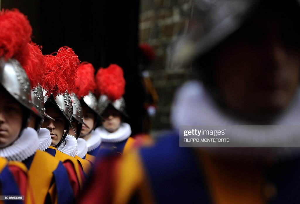 Swiss guards stand during a ceremony on May 6, 2010 at The Vatican in memory of the Swiss guards who died during the sack of Rome. The Swiss guards protected Pope Clement VII at castel San Angelo during the sack of Rome on May 6, 1527.