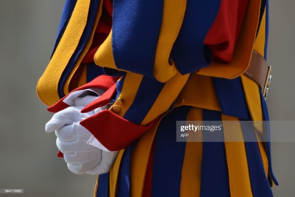 Swiss guards stand during a papal audience at St Peter's square on March 27, 2013 at the Vatican.