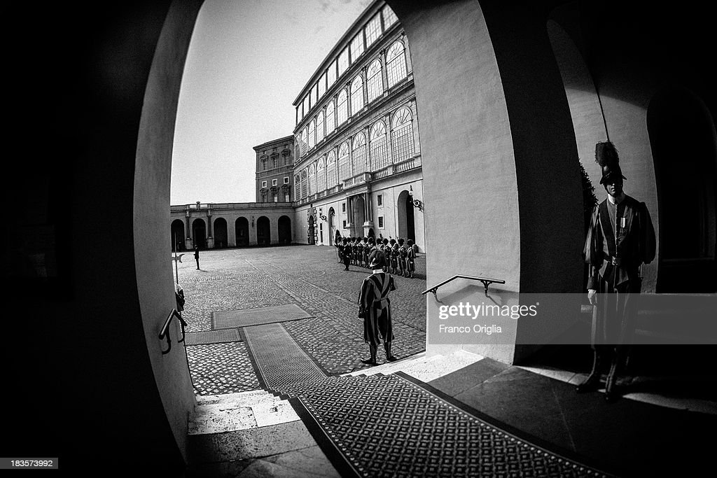 Swiss guards stand inside the 'Cortile di San Damaso in the Apostolic Palace on October 7, 2013 in Vatican City, Vatican. After the success of his Social networking accounts of Twitter and Facebook, Pope Francis joined Instagram, reporting today more than 8000 followers.