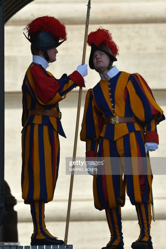 Swiss guards stands at St Peter's square on March 27, 2013 before a papal audience at the Vatican.
