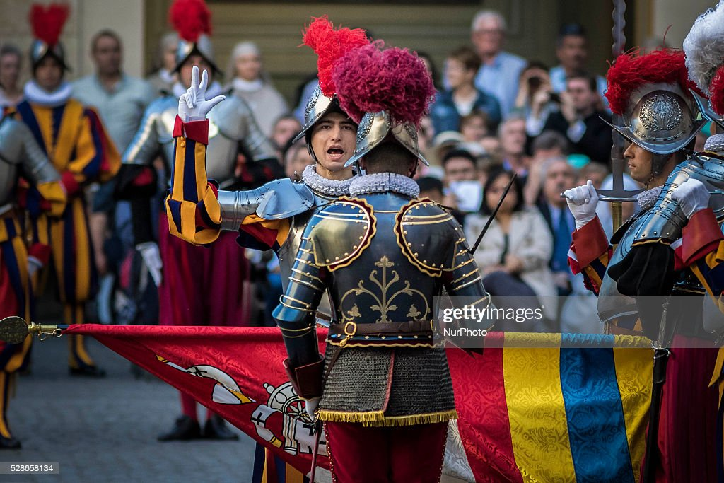 Swiss Guards take part in a swearing-in ceremony in San Damaso Courtyard, Vatican on May 06, 2016. The annual swearing-in ceremony for the new papal Swiss Guards takes place on May 6, commemorating the 147 who died defending Pope Clement VII on the same day in 1527 during the sack of Rome.