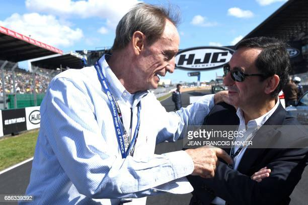 Swiss honorary IOC member JeanClaude Killy and France's President of the Automobile Club de lOuest and in charge of the organisation of the Le Mans...