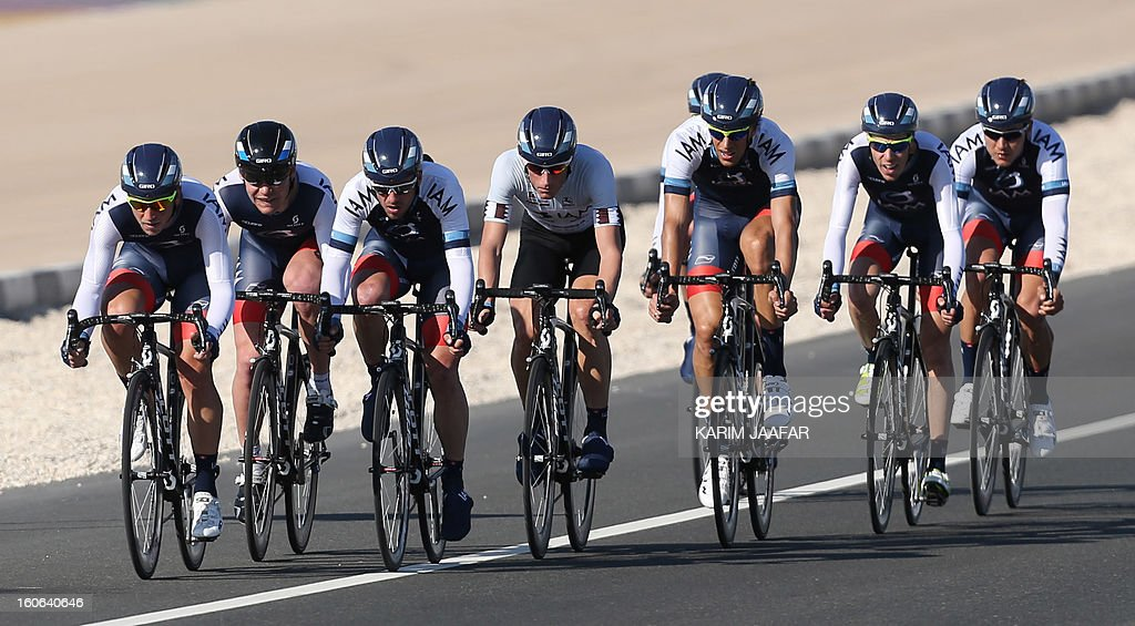 Swiss Iam team's cyclists ride their bikes during the second stage of the 2013 cycling Tour of Qatar, a 14-kilometre team time-trial, in the Qatari capital Doha, on February 4, 2013.