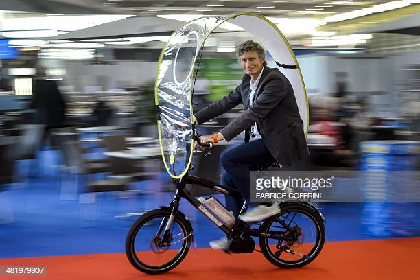 Swiss inventor Rene Wuttig presents on April 2 2014 his creation a foldable protection against rain and bad weather for bicycles and ebikes flexible...