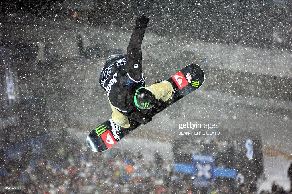 Swiss Louri Podladtchikov competes in the Men's Snowboard Superpipe qualification of the European Winter X-Games, on March 20, 2013 in the ski resort of Tignes, French Alps. AFP PHOTO JEAN-PIERRE CLATOT